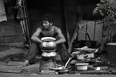   Hunger (Akilselvan Photography   www.akilselvan.com) Tags: life food india white man black waiting with indian hunger tamilnadu slum slums cwc parrys akilan akilselvan wwwakilselvancom