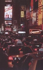 Times Square cabs (McGaggs) Tags: street city trip travel vacation urban usa newyork film car night traffic manhattan timessquare scanned cabs manhatten eos3000v