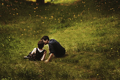 (laura zalenga) Tags: light boy green love nature girl grass yellow dark kiss couple paradise dandelion drama 2012 iman nikond5000 laurazalenga