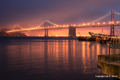 The City by the Bay (idashum) Tags: sanfrancisco city longexposure nightphotography bridge sunset water fog night reflections landscape lights oakland bay nikon cityscape shine treasureisland embarcadero bayarea sanfranciscobay glimmer ida shum portofoakland citybythebay foglights reflectionoflight idashum idacshum