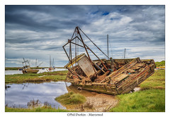 Marooned (Phil Durkin) Tags: old uk sea england clouds boats boat spring decay tide estuary finished beached daytime rotten scrap marooned merseyside heswall thewirral mudbanks