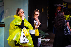 Smokers (Zach Cowan) Tags: street city nyc newyorkcity portrait people urban newyork rain yellow lady canon women cigarette candid streetphotography smoking 7d pancho raincoat