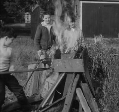 Good bonfire (theirhistory) Tags: boy child kid england uk film childrensfilmfoundation saturdaymorningcinema abcminors rank gaumont bonfire fire burning jumper trousers shirt girl wellies