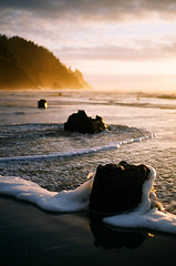 Glow (Benjamin Postlewait) Tags: sunset film beach oregon 35mm waves minoltax700 tide pacificocean shore oregoncoast stumps neskowin superiamaybe
