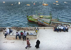 Dockside port Life, Lamu, Kenya (Eric Lafforgue) Tags: africa color horizontal island photography boat couple sitting kenya culture boredom unescoworldheritagesite afrika tradition chatting brotherhood lamu swahili afrique tranquilscene eastafrica passingby dockside onewoman qunia peacefulscene lamuisland lafforgue traveldestination kenyaafrica 123132  qunia    kea exterioroutdoors seaindianocean   tradingroute dhulfiqaar a dhowboatwoodenjahazi donkeymuleanimalsmammalshebivorous midgroupofadults groupofmenman