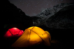 Glowing tents (Alex Treadway) Tags: lighting camping nepal light sleeping red camp two mountain snow mountains expedition yellow blackbackground night stars outdoors photography lights tents asia glow sleep extreme nopeople tent snowcapped adventure explore journey valley midnight environment glowing nightsky nepalese lit copyspace himalaya majestic naturalworld himalayas isolated scenics constellation torchlight highaltitude nepali litup redandyellow dometent traveldestinations colorimage twotents hikingarea trekkingarea trekkingregion manasluregion manasluconservationarea
