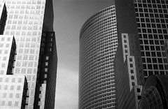 Buildings (missiletest) Tags: nyc newyorkcity sky blackandwhite bw newyork film glass architecture 35mm buildings skyscrapers manhattan rangefinder 35mmfilm fed2 grayscale fed greyscale goldmansachstower 53mm 200weststreet