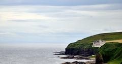 Lonely Scottish house (Dunrobin Castle) (Micadu.ro) Tags: blue sky cliff green castle scotland seaside scotlandcastle