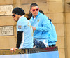 Carlos Tevez and Aleksandar Kolarov Manchester City Premier League Title victory parade. Players and staff of Manchester City parade the English Premier League Trophy through the city centre from an open-top bus Manchester, England