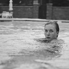 the fear (lanuiop) Tags: summer blackandwhite woman water pool girl look swimming square slick eyes emotion elise bokeh ripple candid poolside glance vulnerable