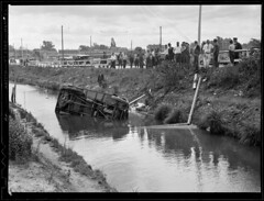 Truck goes off road into ditch (Boston Public Library) Tags: streams lesliejones trafficaccidents