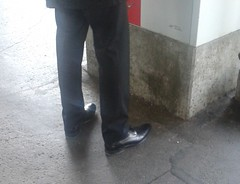 Businessman at the train station! (TBTAOTW2011) Tags: camera man black feet leather businessman silver daddy foot shoe shoes dad dress pants candid business suit hidden mature fox captoe captoes