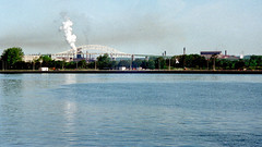 Sault Ste Marie (joeldinda) Tags: vacation sky cloud ontario building tree mill film up june kodak michigan greatlakes scanned 1992 states g3 soo upperpeninsula negatives province saultstemarie chinon sault internationalbridge steelmill gold200 stmarysriver 3093 algomasteel genesisiii chinongeneisiii