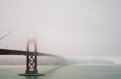 enfolded (manyfires) Tags: california bridge mist film fog analog 35mm bay moody cityscape nikonf100 goldengatebridge marinheadlands