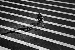 stretching the truth~ Shanghai (~mimo~) Tags: china street sunset shadow woman lines bicycle crossing shanghai streetphotography repetition mimokhairphotography