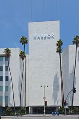 Harbor (Whistler Whatever) Tags: white building tower architecture modern corporate la harbor losangeles sunny bluesky palmtrees intersection tall redlight wilshireboulevard superioroil tidewateroilcompany