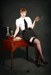 (Jennifer McCready Photography/Lady Luck Pin Ups) Tags: boss woman hot sexy classic film lady table grey noir legs gray cigar skirt chick business booze scotch secretary pinup nylons jennifermccreadyphotography ladyluckpinups