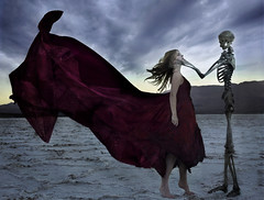 the one who went away (Leah Johnston) Tags: girl skeleton death skull desert fineart romance deathvalley portfolio reddress badwaterbasin kissofdeath drieduplake salfflats skeletonkiss leahjohnston leahjohnstonphotography