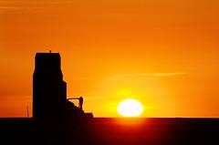 Saturday Night at Stony Beach (Harry2010) Tags: sunset red sun canada silhouette architecture landscape elevator saskatchewan grassland prairies grainelevator stonybeach omot