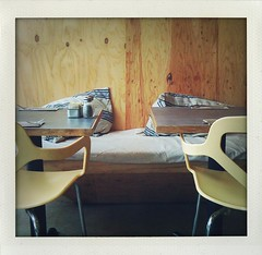 (kitschcafe) Tags: wood bench restaurant la losangeles chairs interior empty pillows tables iphone