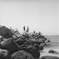 Catch Anything Yet? (dreamscapesxx) Tags: blackandwhite tlr fishermen florida 120film atthebeach twinlensreflex ilfordfp4plus125 yashicamatem passagrillebeach expiredin2005 smallfishingpier notreallycatchingmuch