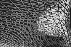 In to the future (PeteZab) Tags: uk roof england blackandwhite bw building london monochrome architecture modern mono railway ceiling trainstation kingscross futuristic 2012 canoneos50d petezab westernconcourse peterzabulis sigma1770f284dcmacroos monomayhem2012
