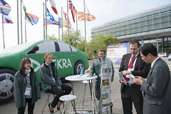 Delegates ask questions at the Dekra stand