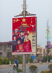 Propaganda Billboard Of The Communist Party, Hanoi, Vietnam (Eric Lafforgue) Tags: people sign vertical person one asia exterior panel propaganda capital fulllength billboard vietnam communist communism hanoi humanbeing oneperson hammerandsickle colorphoto capitalcity communistparty reddao reddzao 8087 daopeople hanoicity