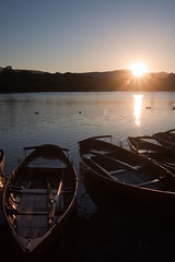 Sun sets over Derwent Water (Miche & Jon Rousell) Tags: blue trees sunset sky lake green reflections boats pier lakedistrict cumbria fells derwentwater