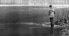 Fishing the Conestoga River (Poocher7) Tags: blackandwhite ontario monochrome reflections river beard glasses hoodie fishing dam shoreline jeans ripples anticipation relaxation stjacobs youngman rubberboots wading rodandreel conestogariver