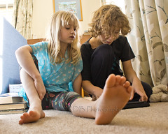 Cousins behind the Couch 2 (C & R Driver-Burgess) Tags: family boy playing girl carpet foot toes sister cousins brother curls together blonde tablet