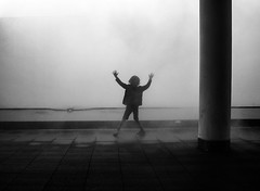 Foggy Street (Georgie Pauwels) Tags: blackandwhite fog kid child geometry candid smoke foggy streetphotography surreal olympus minimal minimalism emotions