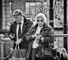 Messaging II (tootdood) Tags: blackandwhite mobile manchester phone cell piccadilly messaging streetcandid canon600d