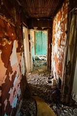 down the hall (Sam Scholes) Tags: door old red house green abandoned digital rural utah decay dirty hallway doorway peelingpaint decrepit hiawatha d300 kingcoal usfco unitedstatesfuelcompany