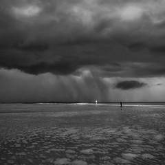 Heavy rain (Ludovic Cadet Photo) Tags: blackandwhite storm beach clouds canon day noiretblanc nuages plage averse