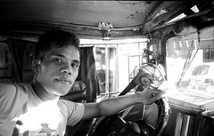 "Manila, The Philippines. View this and all other photos by going to my ""profile"" and clicking this link as Flickr viewer is shit. http://flickeflu.com/photos/46412793@N07 (Serum 114) Tags: manila thephilippines jeepneydriver"