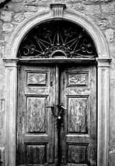 Kotor Door (Garbo_) Tags: door blackandwhite bw film blackwhite grain kodaktrix canona1 padlock montenegro kotor canonfd50mmf14