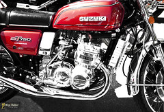Suzuki GT750 (~FreeBirD~) Tags: uk red england bw reflection classic metal logo japanese britain starter spokes wheels pipes fast chrome motorcycle suzuki gt tyres kickstart exhaust reflector madeinjapan 750 downpipes gt750 discbrakes classicmotorcycles liquidcooled spokewheels britishmotorcycling suzukigt750 suzukigt suzukijapan manibabbarphotography