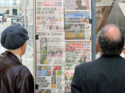 Reading the newspapers, Lisbon, Portugal