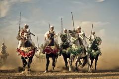 Fantasia Riders (aminefassi) Tags: world africa copyright horse sport caballo cheval lumix culture arabic panasonic morocco maroc fantasia getty cavalier tradition b