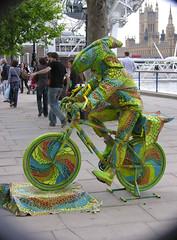 Karma Chameleon (crusader752) Tags: street london bicycle weird crowd sightseeing housesofparliament londoneye tourists southbank odd cycle entertainer karma chameleon walkers boygeorge strolling redgoldandgreen