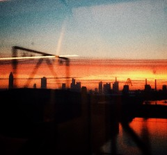 dawn on the train (stromlinienbaby) Tags: morning bridge light sky sunlight skyline train river dawn ride frankfurt commuting morningglory