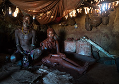 Hamer tribe teenage girl called a uta and her future stepfather who keeps her 6 months in a hut, Omo valley, Turmi, Ethiopia (Eric Lafforgue) Tags: africa red people orange house color girl vertical horizontal hair outdoors photography necklace adult african tribal redclay indoors hut blackpeople omovalley tradition ethiopia tribe ochre ethnic adults hairstyle 2people twopeople pigment hamar developingcountry hamer lifestyles hornofafrica ethnology ethiopian eastafrica abyssinia realpeople blackskin wifetobe tobemarried turmi africanethnicity indigenousculture africanculture ethnicgroup omotic blackethnicity ethiopianethnicity ethio161435