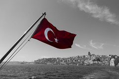 - Cruising The Bosporus - (Mr. LookUP) Tags: city red sea sky bw clouds canon blackwhite unique flag wideangle istanbul 1855mm waving f28 bosporus blackandwithe 60d