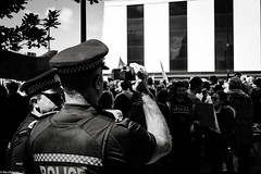 Watching you watching us (RexJAdams) Tags: police surveillance protest march bnw mono monochrome fujixseries fujixfamily fujifamily fujifeed fujifilm fujixt1 fujinonxf35