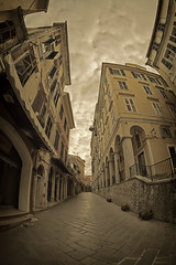 empty street (dtsortanidis) Tags: life street city sky people color colour yellow sepia clouds photoshop canon buildings lens island town holidays colours mark empty fisheye greece ii 5d corfu kerkyra vacations ef momochrome 815mm