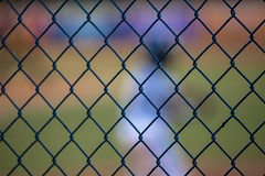 Baseball through a fence (Mabry Campbell) Tags: people usa playing blur color sports field kids fence ball photography us photo team texas play unitedstates baseball little unitedstatesofamerica houston player outoffocus photograph april 800 f28 league 2012 playball 200mm harriscounty throughafence ef200mmf28liiusm sec mabrycampbell april272012 201204277869