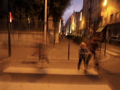 Scooter ghosts (Ronan Collett) Tags: street france night pen children play lyon candid ghost scooter olympus outoffocus ghosts effect atmospheric ep1 peopleandpaths olympusmotion