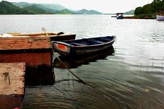 Castaway (picturesbypriyesh) Tags: blue lake yellow island boat ngc rope anchor tether flickrcolor