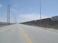 Cargo Leaving To The Horizon (haymarketrebel) Tags: california railroad port train horizon streetscene powerlines shippingcontainers